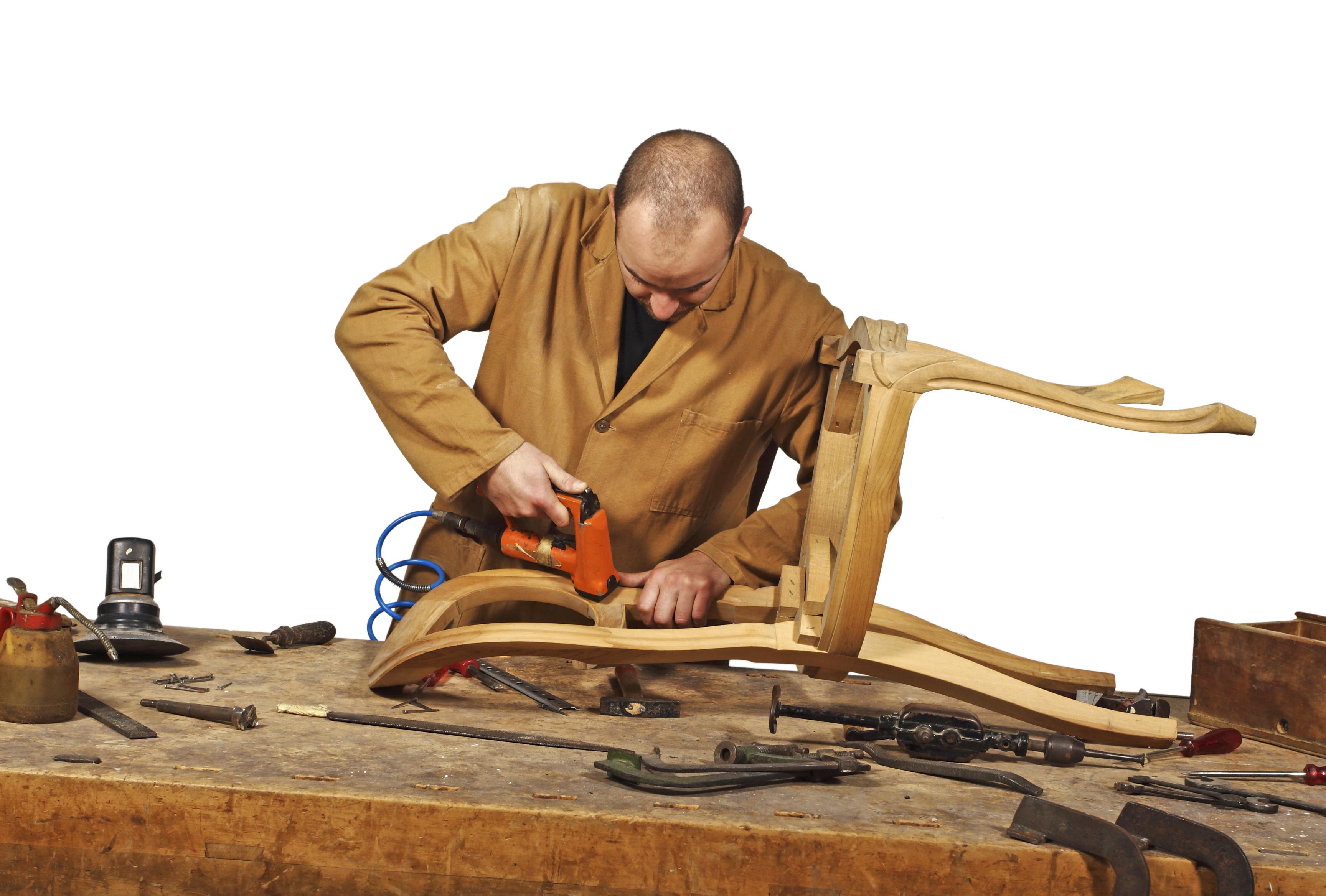 Man Fixing A Chair